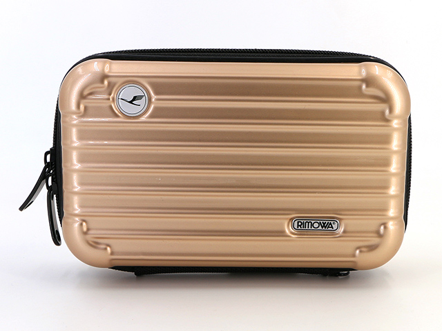Makeup case with brush compartment in golden champagne color